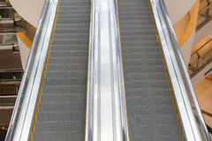 Escalator in a mall Stock Images