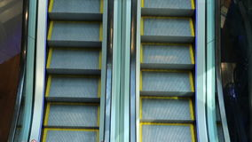The escalator mechanism movement step climbing. The escalator mechanism movement step and climbing stock footage