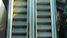 The escalator mechanism movement step climbing stock video footage