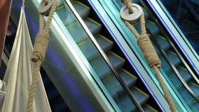 The escalator mechanism movement step climbing. The escalator mechanism movement step and climbing stock video footage
