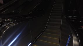 Escalator at Metro Station in movement. The Stockholm Metro, the World's Largest Underground Art Museum. Escalator in movement. Using of glidecam stock video footage