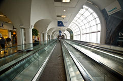 Escalator in modern airport hall Royalty Free Stock Image