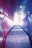 Escalator. Modern escalator in blue with sun flares Stock Images