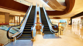 Escalator in shopping mall. Escalator inside fashion shopping mall. Interior of modern commercial building with escalator Stock Image