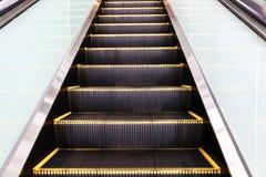 An escalator in modern office building Stock Photos