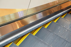 Escalator and modern shopping mall Royalty Free Stock Images