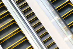 Escalator in the modern shopping mall. The multiple steps and directions of an escalator in the modern shopping mall Royalty Free Stock Photo