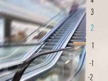 Escalator in modern shopping mall, side view. Billboard with floors navigation on the right. Escalator in modern shopping mall, side view Royalty Free Stock Images