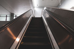 Escalator is modern in station of city Stock Photos