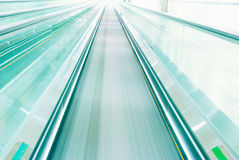 Escalator in motion Stock Image