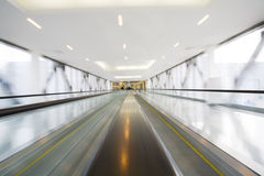 Escalator with motion blur Stock Photography