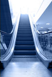 Escalator move up. Escalator in business center move up Royalty Free Stock Photo