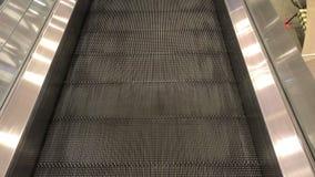 Escalator movement in the mall. Empty escalator movement in mall stock video footage