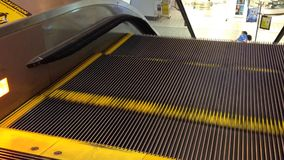 Escalator moves up. One side of escalator moves up stock video footage