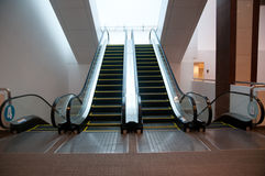 The escalator moving. Many escalators moving indoor Stock Images