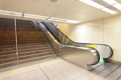 The escalator moving at a metro railway station Stock Images