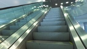 Escalator moving up stock video footage
