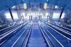 Escalator in new airport terminal. With no people staircase Royalty Free Stock Photo