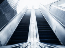 Escalator in office building Blue toned images. Escalator in Modern building Business concept Stock Image
