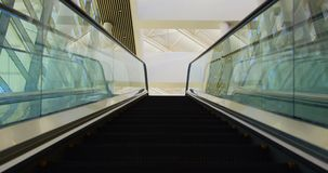 Escalator in the office 4k. Low angle view of an empty modern escalator in the office 4k stock video footage