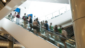 Escalator with passengers motion blur. Escalator in shopping mall with passengers motion blur royalty free stock photos