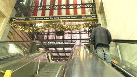 Penn Station. The escalator at Penn Station, in New York City, at Christmastime stock footage