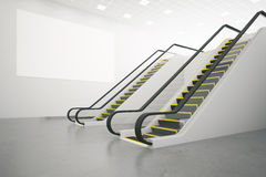 Escalator and poster side. Side view of two escalator and blank poster in concrete interior. Mock up, 3D Rendering Stock Image
