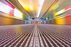 Escalator Runway. Photograph taken with a long shutter while traveling down an airport escalator Stock Photo
