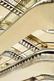 Escalator set in various plains, vertical frame. Stock Image