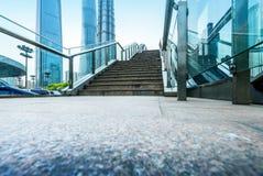 Escalator of Shanghai streets, skyscraper buildings. Stock Photos