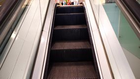 Escalator in shopping or business center. Escalator moving up in shopping or business center stock video