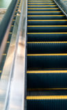 Escalator in shopping mall Stock Images