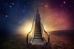 Escalator sky. An escalator goes up to the night sky Royalty Free Stock Image