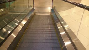 Escalator slowly moving down, reaching end, shopping mall. Stock footage stock video footage