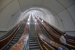 Escalator of the St. Petersburg subway. St. Petersburg, Russia - March 20, 2017: Metro escalator during the minimum transport load Stock Photography