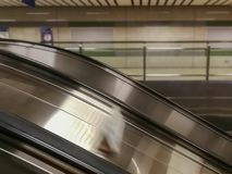 Escalator stair rail inside the subway station. Escalator stair rail inside the subway station, blurred motion and unfocused background Royalty Free Stock Photo