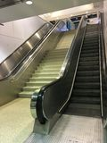 Escalator and staircase. An escalator and a flight of stairs next to it Royalty Free Stock Photography