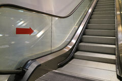 Escalator staircase in a shopping mall, leading up from the basement. Background Stock Image