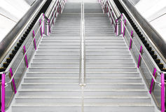 Escalator and stairs. Long escalator and high stairs in public sky train station Stock Image