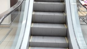 Escalator stairs in mall - moving staircase running up. Close up stock footage