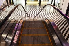 Escalator without stairs in a shopping mall. Moving down staircase. Close up metal platform. Top view Royalty Free Stock Image