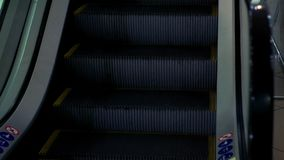 Escalator stairs. Steps escalator go up. Close up staircase steps escalator riding up stock footage