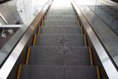 Escalator. Steel escalator running in somewhere Royalty Free Stock Photo