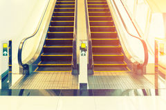 Escalator Step Floor. Escalator step and white tile floor inside building Stock Image