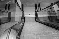 Escalator steps down, up in the room. Funny photo Stock Images