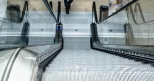 Escalator steps down, up in the room. Funny photo Stock Photo