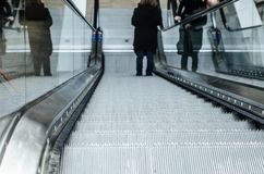 Escalator steps down, up in the room. Funny photo Royalty Free Stock Photography