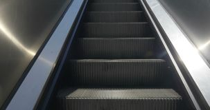 Escalators Going Up. An escalator steps rising upward stock video footage