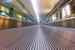 Escalator Stress. Photograph taken with a long shutter across a moving airport escalator Stock Image