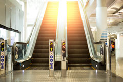 Escalator with sunlight flare in the airport. Empty escalator with sunlight flare in the airport Stock Photos